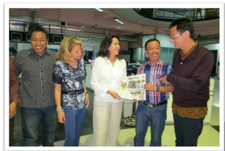 Hot-off-the press: Abdul Rokhim, Kartika, Arif Santoso and Karim checking out the new edition of the Jawa Pos.